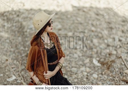 Beautiful Stylish Boho Woman In Sunglasses And Hat, Fringe Poncho And Leather Hat. Hipster Girl In G