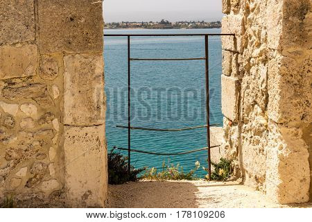 Scenic view of Maniace castle on sea Syracuse Sicily Italy