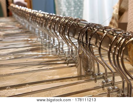 many steel coat hooks in the shop of fashion clothes