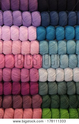 background of balls of wool in the store
