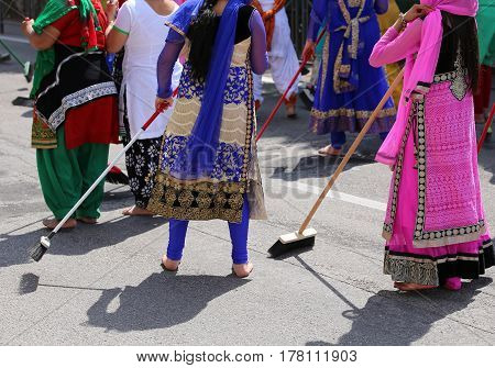 Sikh Women While Scavenging The Street With A Broom During A Cer