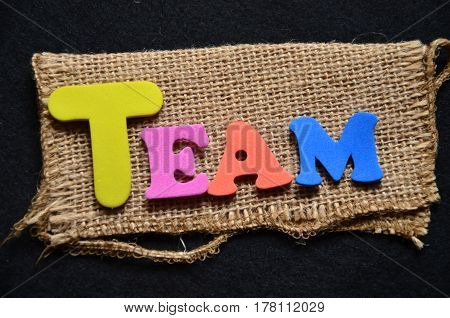 word team on a  aabstract colorful background