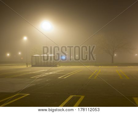 a foggy morning at the bus stop