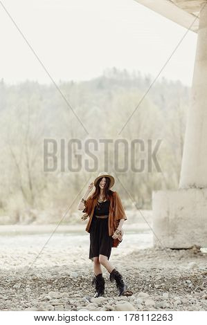 Beautiful Stylish Boho Woman Smiling, With Hat, Fringe Poncho. Girl In Gypsy Hippie Look Young Trave