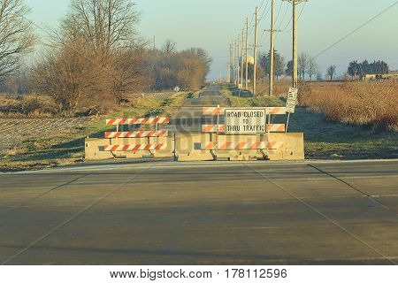 a road closed with signs and barriers