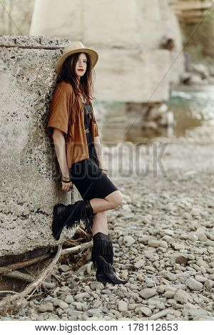 Beautiful Stylish Hipster Woman In Hat, Fringe Poncho And Boots. Boho Traveler Girl In Gypsy Look, N