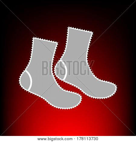 Socks sign. Postage stamp or old photo style on red-black gradient background.