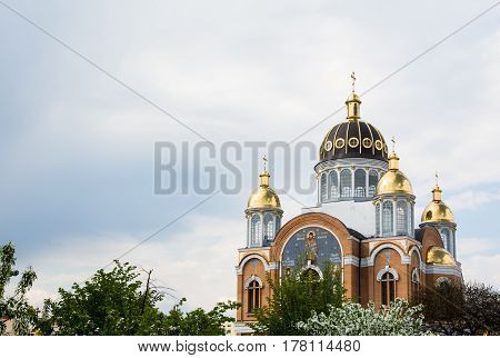 New orthodox church with golden domes in spring build in 1990's in Kiev the capital of Ukraine