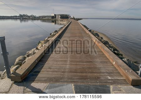 ASSENS DENMARK - MARCH 24 2017: Modern designed walkway on pier a springtime day close to the sea. March 24 2017 Assens Funen Denmark.