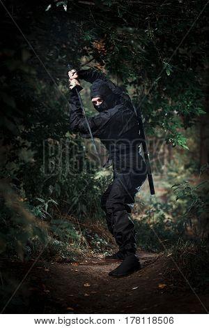 Ninja Silent Killer Waits In Ambush In Forest Undergrowth