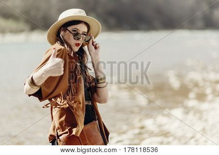 Stylish Hipster Boho Woman Smiling Showing Thumb Up, In Sunglasses With Hat, Leather Bag, Fringe Pon