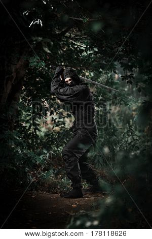Ninja Silent Killer Waits In Ambush In Forest Undergrowth