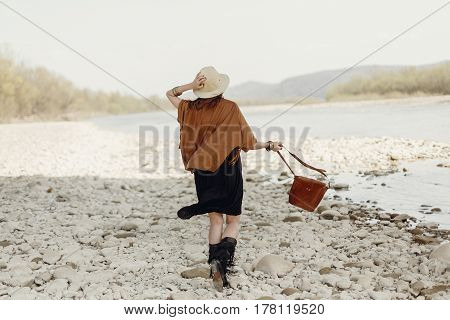 Happy Stylish Hipster Traveler Woman In Hat, Fringe Poncho Back View, Walking Near  River, Gypsy Boh