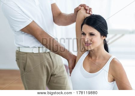 Doctor examining and giving physiotherapy to pregnant woman