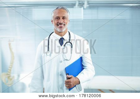 Portrait of doctor standing in clinic
