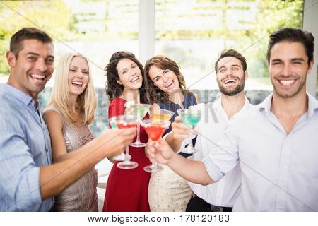 Group of friends having cocktail at the party