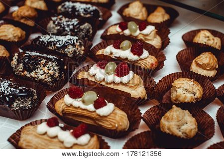 Eclairs traditional french dessert. candybar on a white table