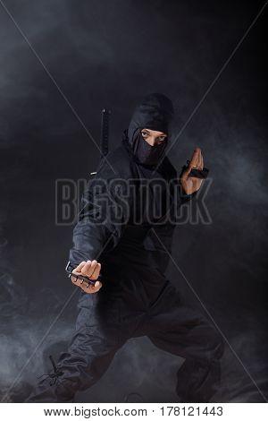 Ninja pull out the sword on black