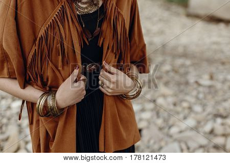 Stylish Hipster Boho Traveler Woman Look. Gypsy Girl In Fringe Jacket With Feather Bronze Accessory.