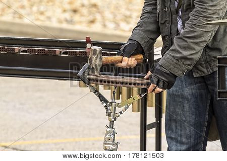 a weird percussion instrument be played with a hammer