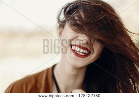 Happy Stylish Hipster Traveler Woman Having Fun Waving Hair And Smiling, Gypsy Boho Girl. Wanderlust