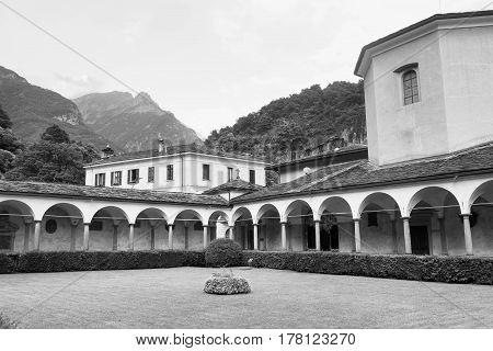 Chiavenna (Sondrio Lombardy Italy): cloister of the historic collegiata of San Lorenzo. Black and white