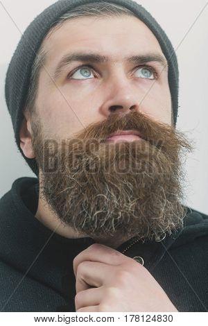 Bearded Serious Brutal Caucasian Man In Black Hat
