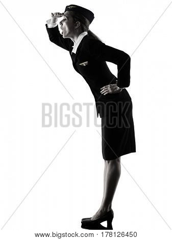 one caucasian Stewardess cabin crew  woman  looking away surprised  isolated on white background in  silhouette