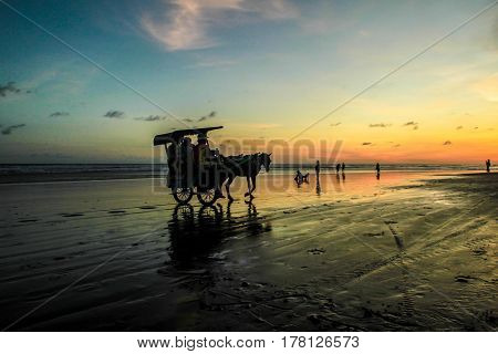 Sunset and silhouette at Parangtritis Beach, Central Java Indonesia
