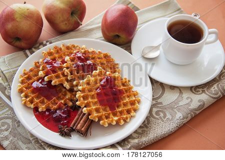 crispy waffles with cranverry syrup and coffee