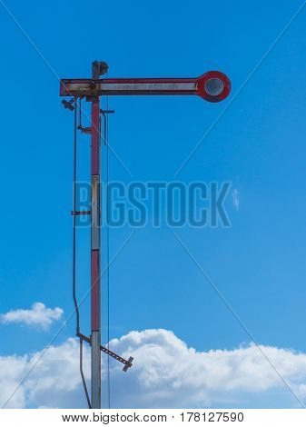old dameged railroad signal and blue sky