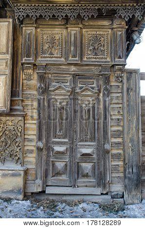 Old wooden door with the wooden carved. Irkutsk russia