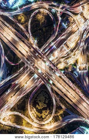 The light on the road roundabout at night and the city in Bangkok Thailand. Aerial view Top view.Light scenic road. cityscape Rush hour traffic jam
