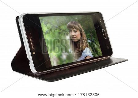 The smartphone in a cover it is isolated on a white background