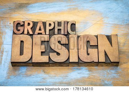 graphic design typography - word abstract in vintage letterpress wood type  against grunge wooden background