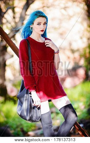 Portrait of a pretty rock girl with blue hair