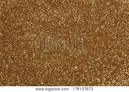 Sparkling, metallic, golden, sequined textile for disco, party or fashion designs toned