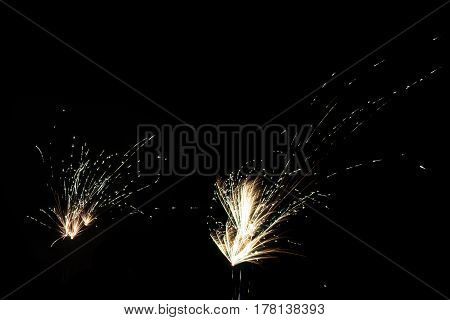 Double exploding fireworks in the night sky