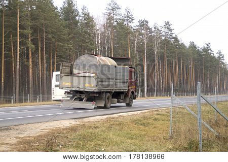 The truck carries a large metal tank