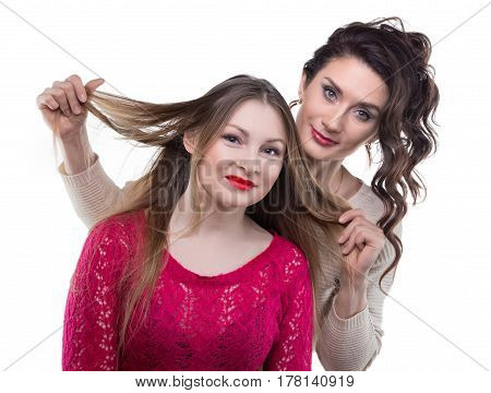 Hairstylist and smiling client on white background