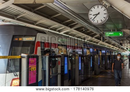Bts Skytrain Train With Clock At Station