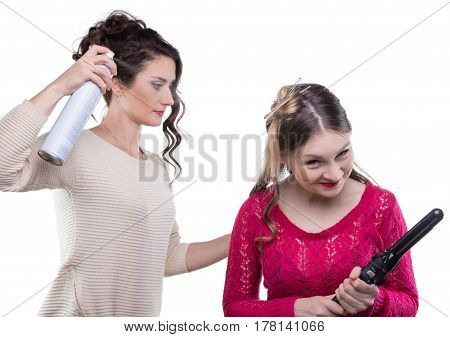 Working hairstylist with hairspray on white background