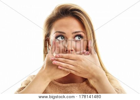 Afraid woman looking at camera isolated on a white background