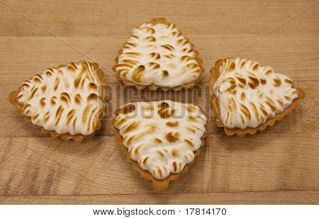 Four Lemon Tartlets With Italian Meringue