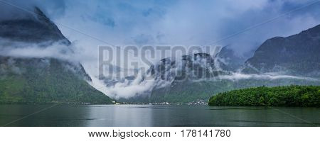 Rain And Clouds Under Mountain Lake In Hallstatt In Spring