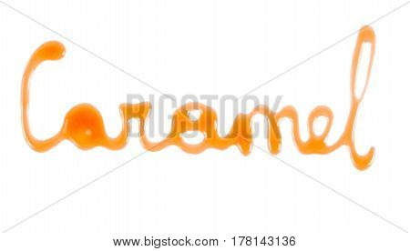 Word Caramel written with caramel sauce over white background