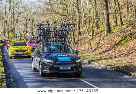 Cote de Senlisse France - 5 March 2017: Group of technical cars driving up on Cote de Senlisse during the first stage of Paris-nice on 05 March 2017.