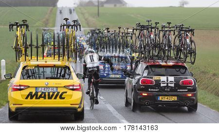 Chateau-RenardFrance - March 062017: The cyclist Roy Curvers of Team Sunweb takes food from the technical car of the team while riding during the stage 2 of Paris Nice on March 06 2017.