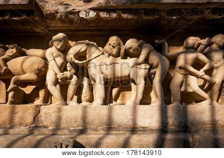 Intimate Life Of Ancient People On Stone Relief On Wall Of Khajuraho Temple, India.