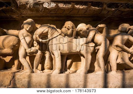 Famous Erotic Stone Carving Bas Relieves, Lakshmana Temple, Khajuraho, India.